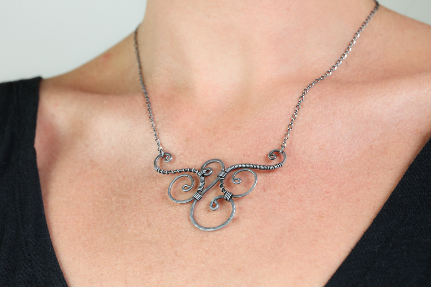 Vintage hammered silver tone wire-wrapped metal cross on 30\u201d chain